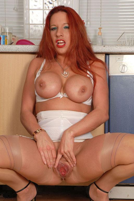 Busty redhead babe Faye Rampton spreading her puss