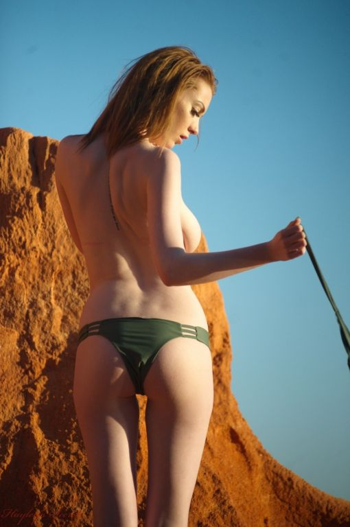 Alice Brookes strips out of her green bikini outsi
