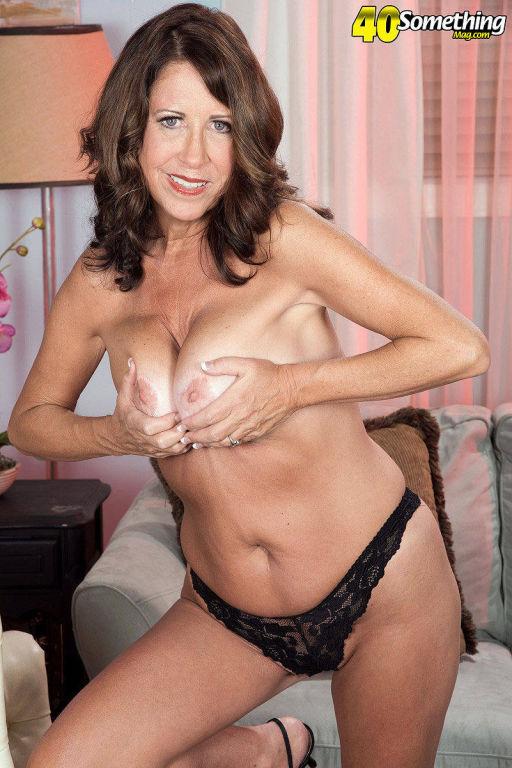Mature lady Karen DeVille spreading her tits
