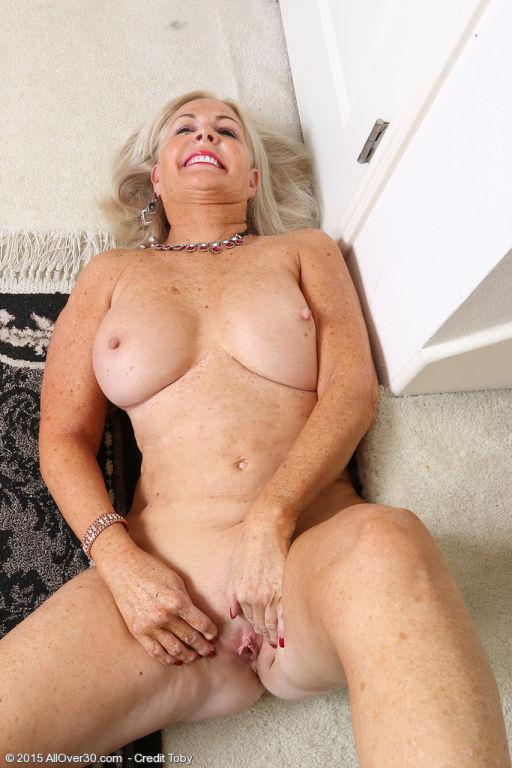 Classy mature Judy Mayflower shows big breasts &am