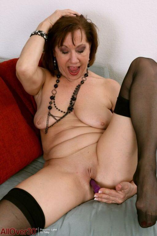 Elle Denay horny mature in black stockings toying