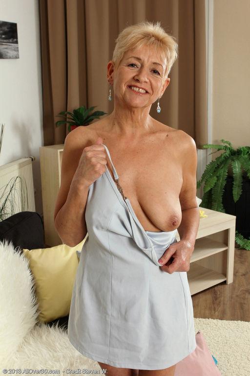 Horny older granny Scarlett J gets naked to fondle