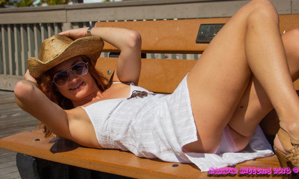 Redhead Julia flashing upskirt on the pier