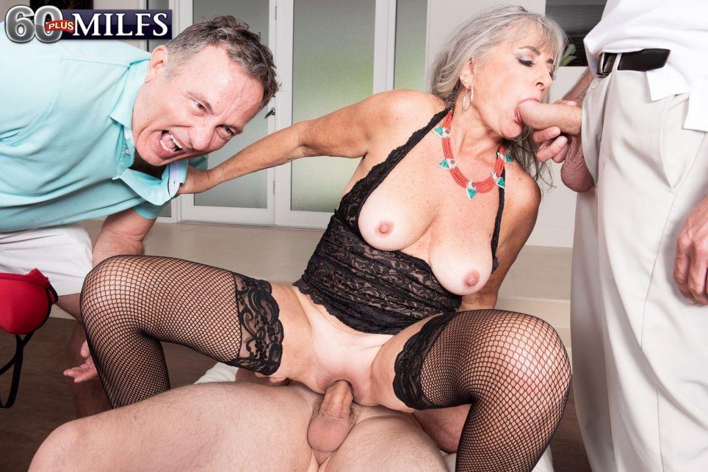 Horny granny Silva Foxx sucks off 2 men while her