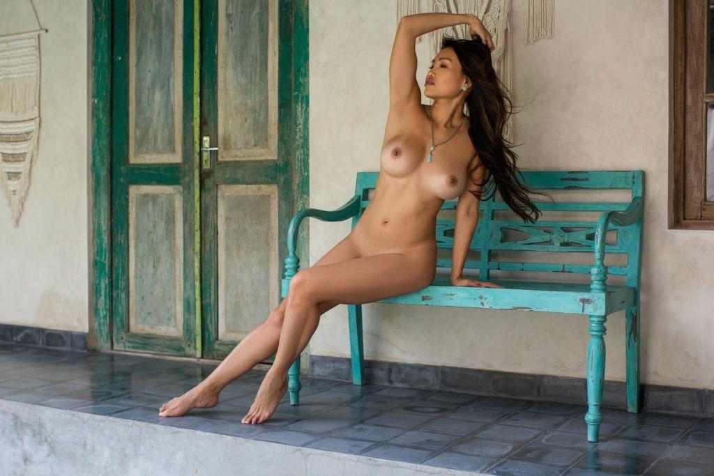 Hot busty exotic babe in a white bikini