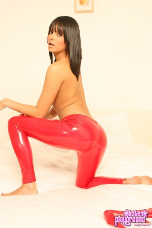 Hot Sasha Cane teasing in tight shiny red pants