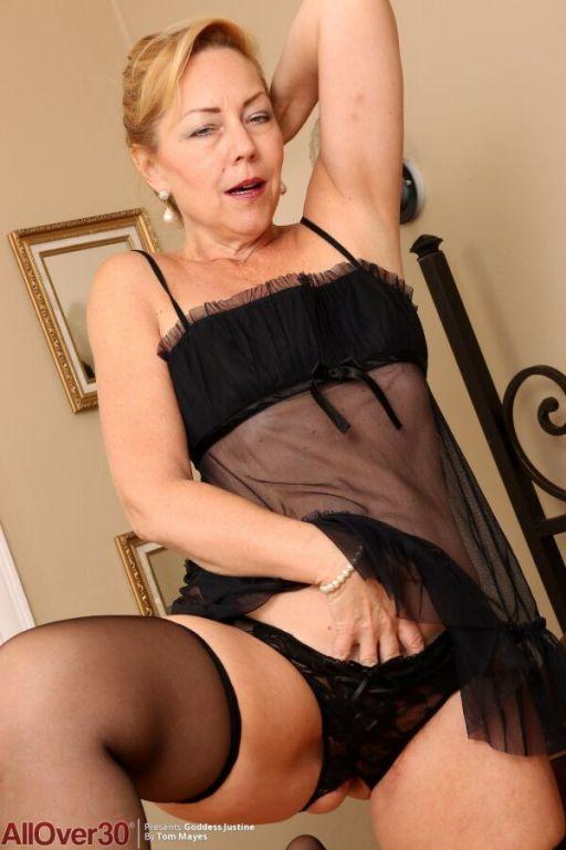 Badd Gramma in black lingerie and stockings spread