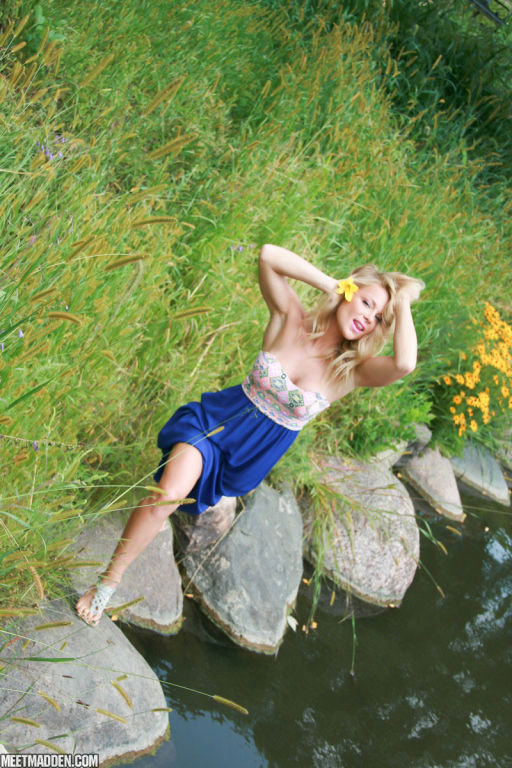 Meet Madden posing outside in her long blue skirt