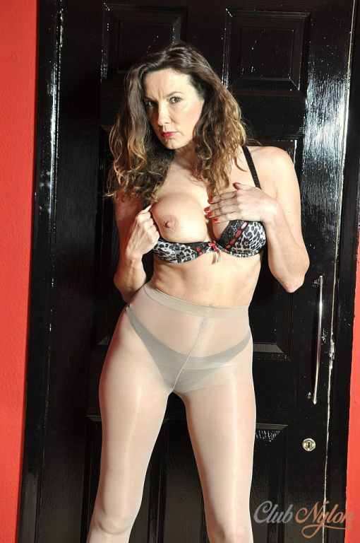 Sexy Milf Nylon Jane shows off her curves in nylon