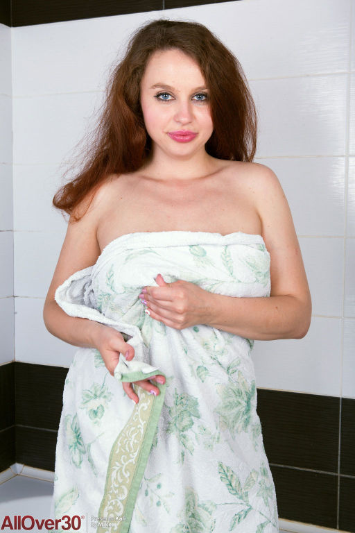 Busty curvy wet wife in the bathtub