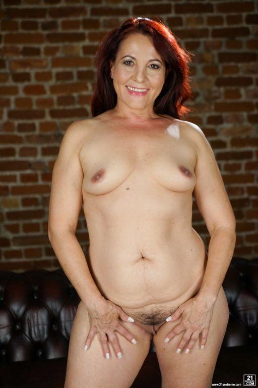 Redhead granny Red Mary is masturbating