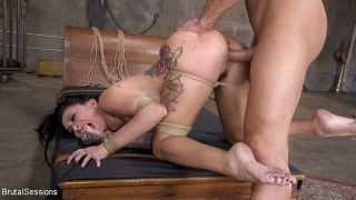 Lily Lane busty babe is bound with chains for span
