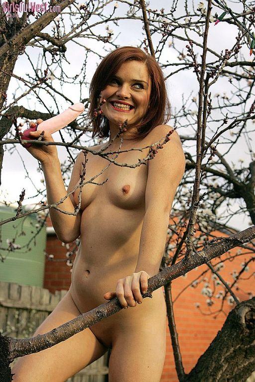 Daisy strips and masturbates with dildo outdoors