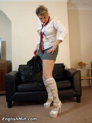 Big ass Milf in her naughty schoolgirl uniform