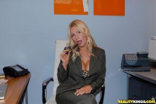 Blonde Ingrid Swenson takes cumshot on her huge ro