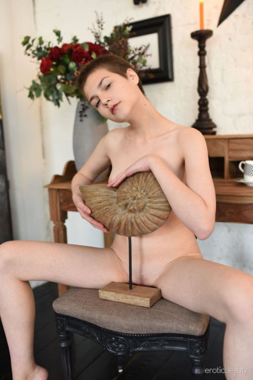 Jerricka strips on the chair as she displays her c