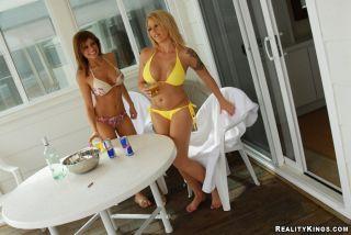 Brooke Haven and Lisa Daniels take off their bikin