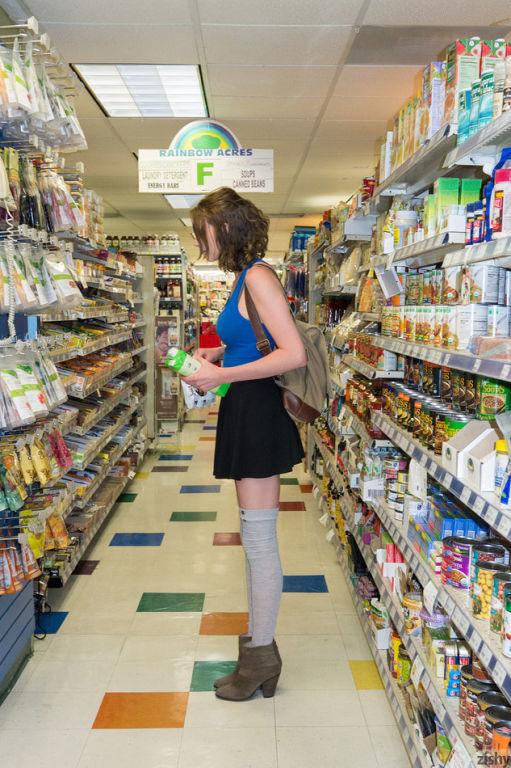 Busty teen babe Anya Amsel flashing in the shop