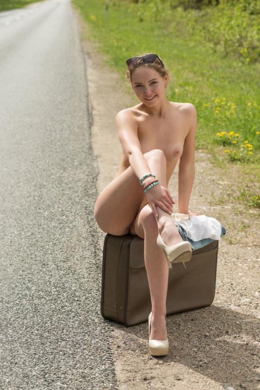 Young lady Faina Bona set Hitchhiker by MetArt