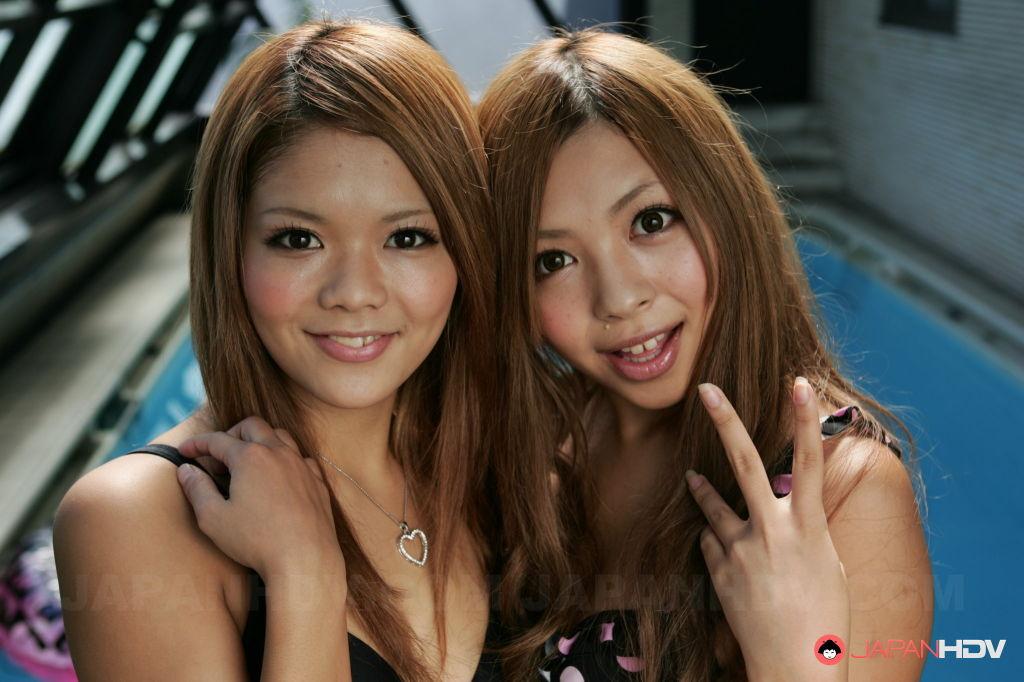 Tsubasa and  Kanon are posing