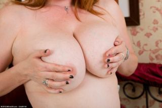 Lucy Williams busty redhead mom poses in black sto