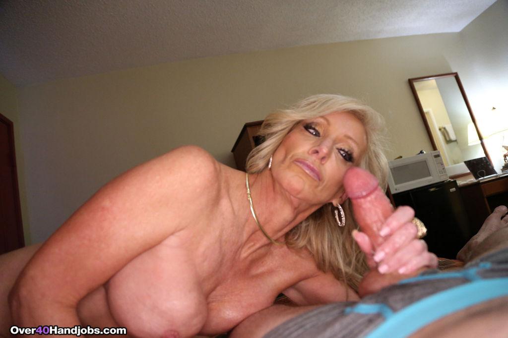 Tiffany slides hard cock between her massive tits