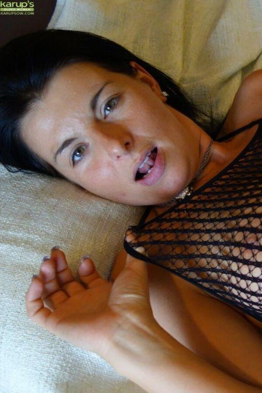 Sandra Nero busty milf in fishnet lingerie and sto