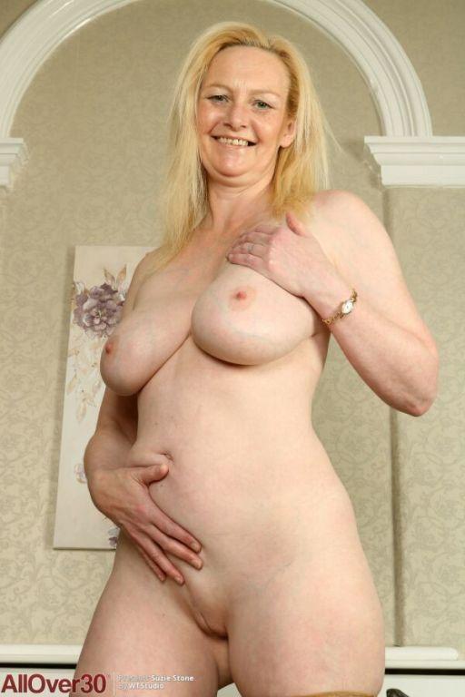 Suzie Stone bigboobs mature blonde poses in tan st