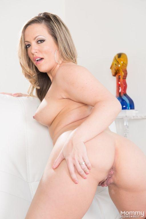 Skirt-wearing blonde MILF taking a meaty cock upsi