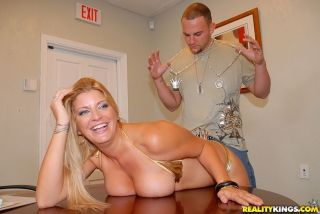 Juicy office blonde strips down to her golden biki
