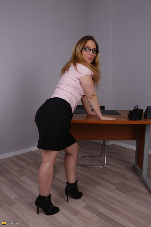 German wife Lilly Ladina stripping in the office