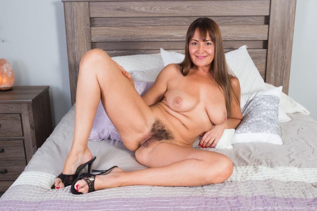 Elexis Monroe enjoys her purple lingerie in bed