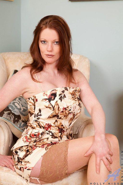 Pale-skinned redhead Holly in beige stockings flas