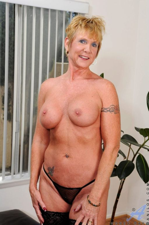 Blonde mature Honey Ray in pantyhose strips linger