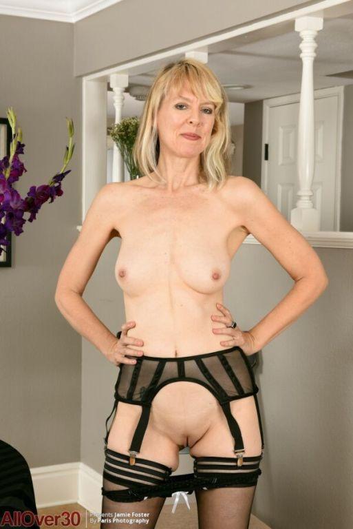 Jamie Foster longlegged milf blonde in black stock