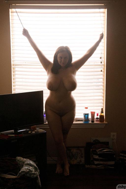 Hot busty amateur brunette with huge tits