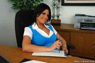 Busty secretary strips down to her black lingerie