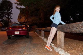 Pretty redhead girl Rose Belford having fun outdoo