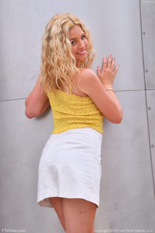 Stunning leggy blonde in a white skirt