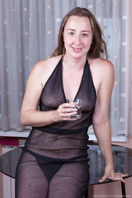 Lucia Siberia slides off a sheer black dress