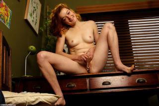 Blonde amateur Jessie plays with her glass dildo