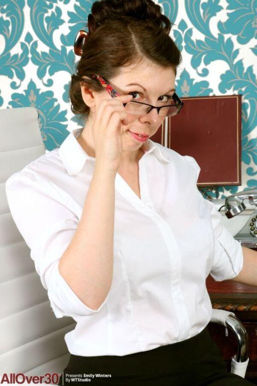 Emily Winters busty secretary in stockings strips