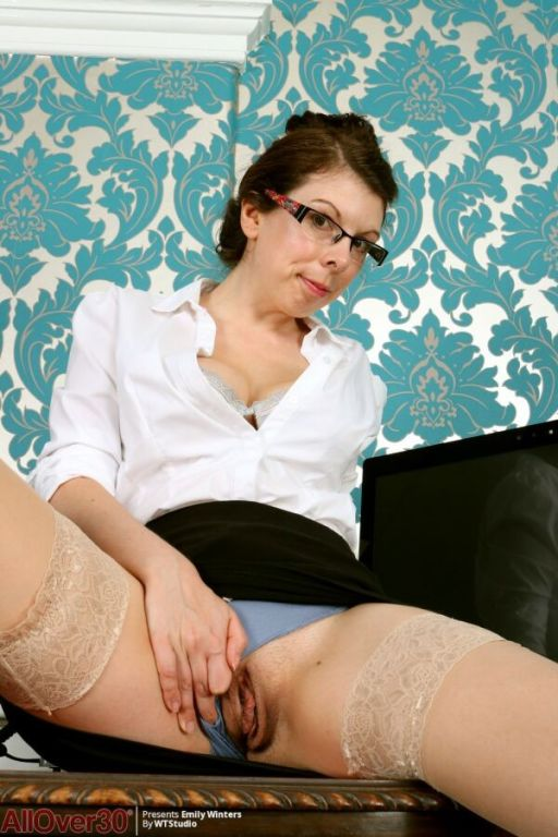 Emily Winters busty secretary in stockings strips