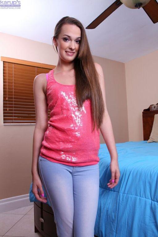 Vanessa Renee sexy beauty in pink lingerie strips