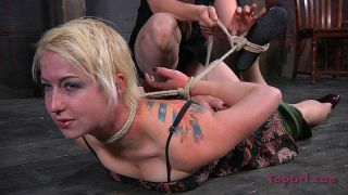 Niki Nymph busty blonde is bound in rope and toye