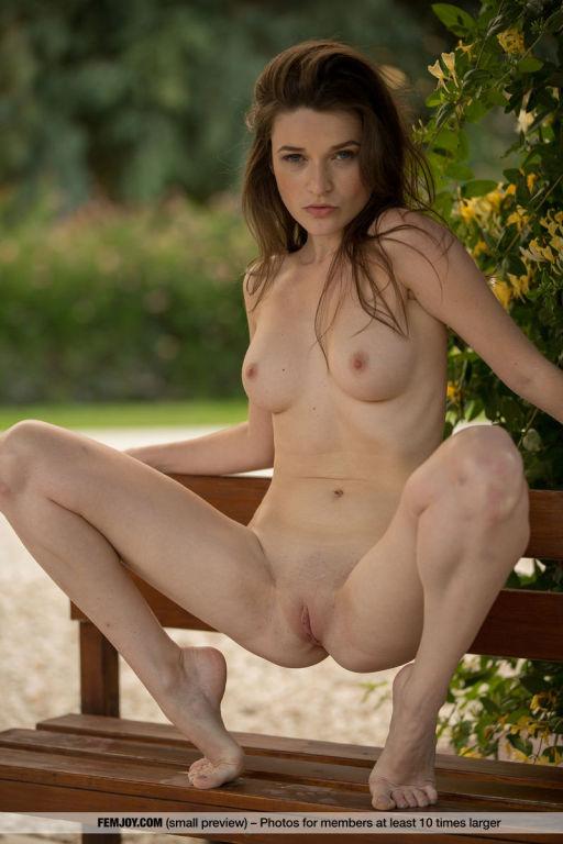 Lovely brunette Serena Wood teasing naked outdoors
