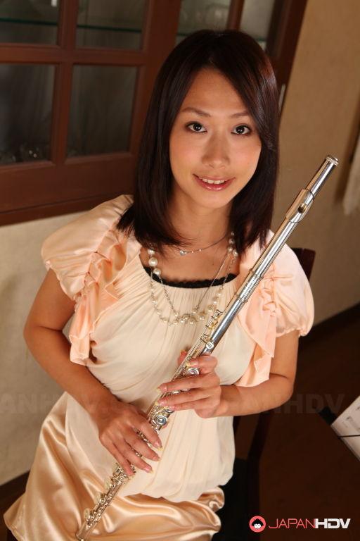 Yayoi Yanagida posing with a flute