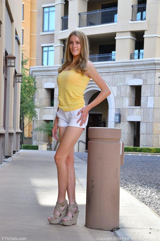 Leggy girl next door posing in white shorts