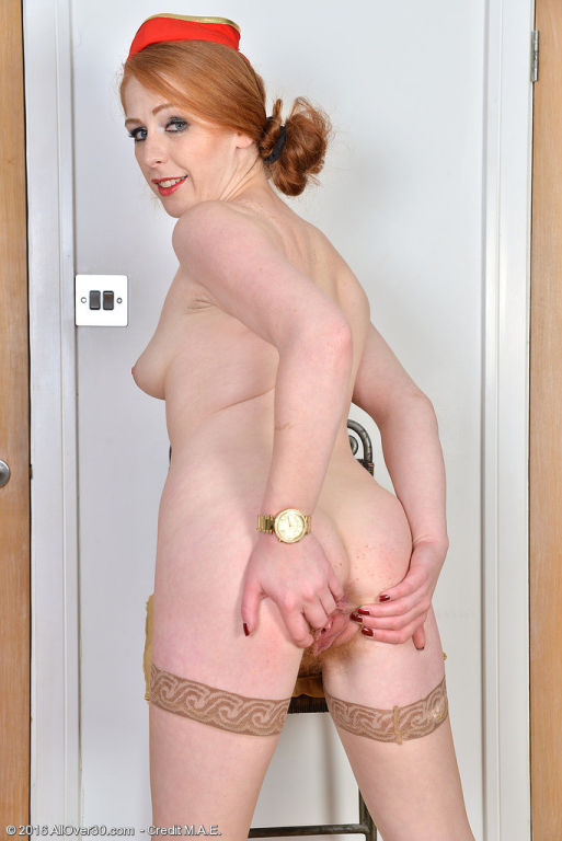 Gorgeous redhead stewardess Tia Jones gets home