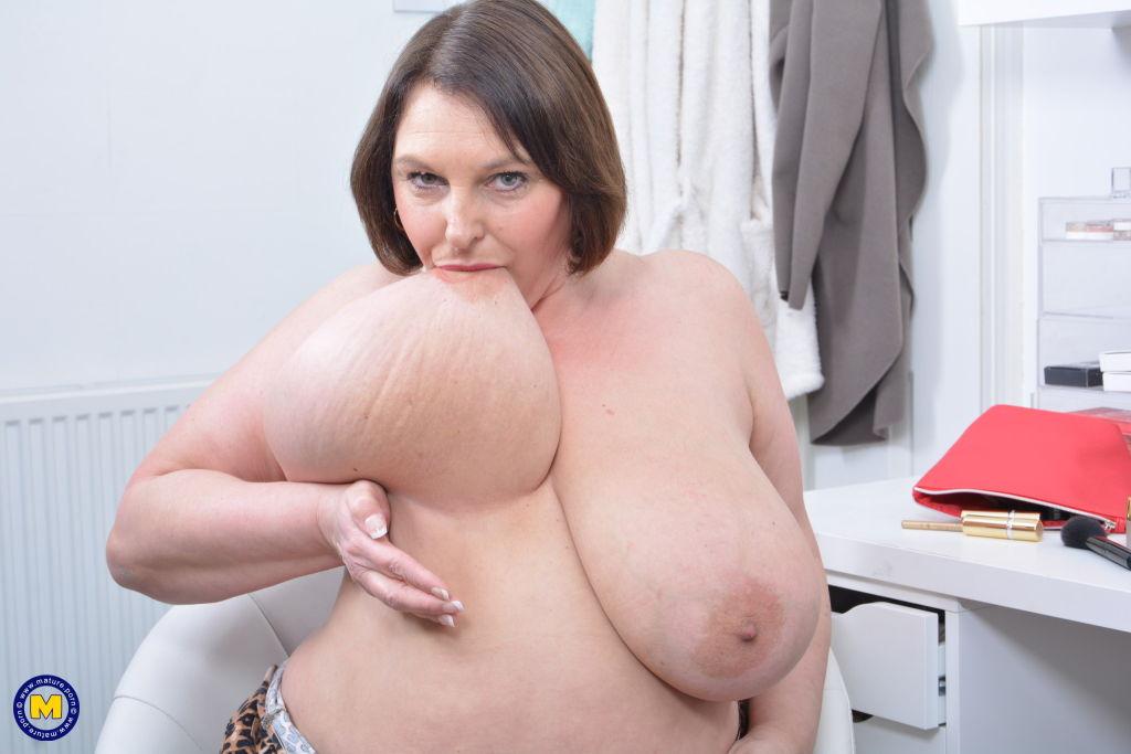 Huge breasted Carol Brown plays with herself